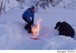 Dr. Katey Walter lights a pond leaking methane ablaze in Northeast Siberia